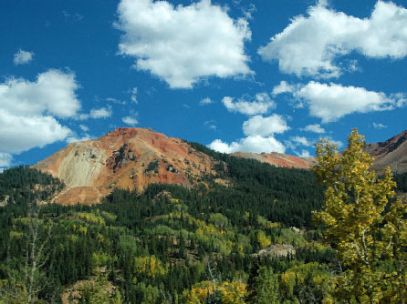 A beautiful autumn day in Colorado's Rocky Mountains, with golden aspen trees.